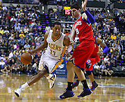 April 21, 2012; Indianapolis, IN, USA; Indiana Pacers small forward Danny Granger (33) dribbles around Philadelphia 76ers center Nikola Vucevic (8) at Bankers Life Fieldhouse. Philadelphia defeated Indiana 109-106. Mandatory credit: Michael Hickey-US PRESSWIRE