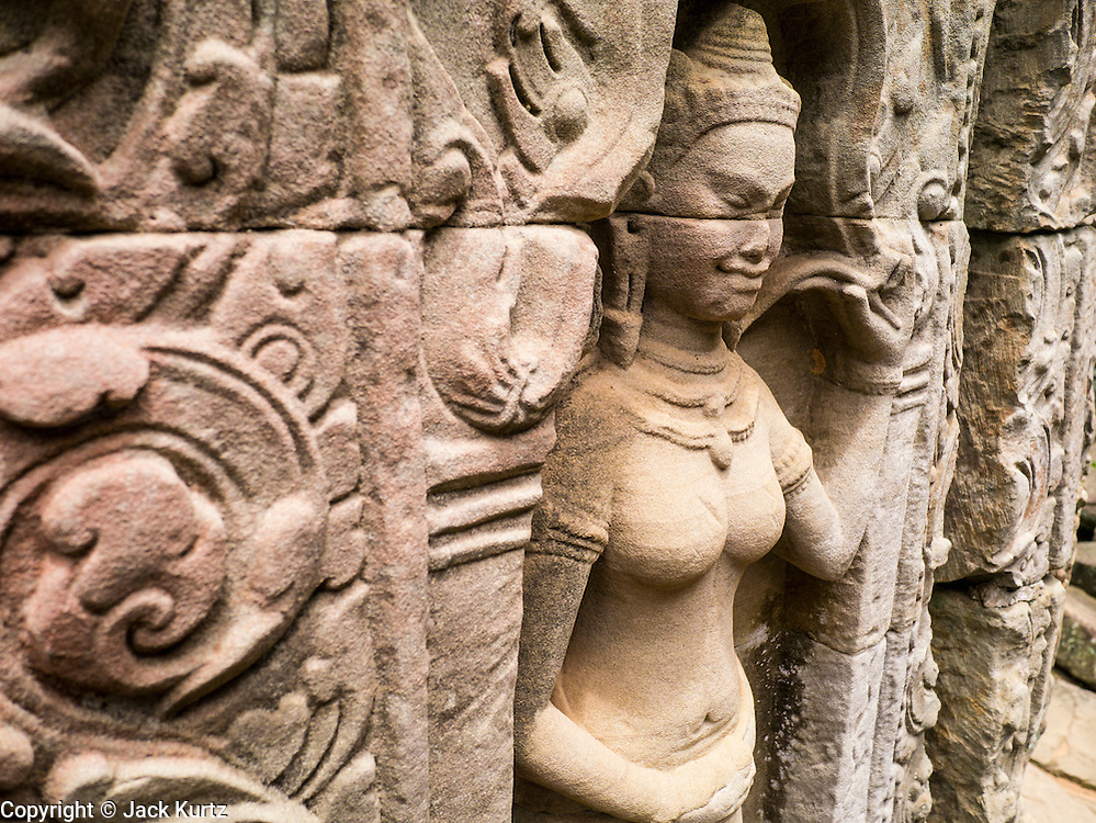 "02 JULY 2013 - ANGKOR WAT, SIEM REAP, SIEM REAP, CAMBODIA:  A bas relief of an Aspara dancer at Preah Khan in the Angkor Wat complex. Angkor Wat is the largest temple complex in the world. The temple was built by the Khmer King Suryavarman II in the early 12th century in Yasodharapura (present-day Angkor), the capital of the Khmer Empire, as his state temple and eventual mausoleum. Angkor Wat was dedicated to Vishnu. It is the best-preserved temple at the site, and has remained a religious centre since its foundation – first Hindu, then Buddhist. The temple is at the top of the high classical style of Khmer architecture. It is a symbol of Cambodia, appearing on the national flag, and it is the country's prime attraction for visitors. The temple is admired for the architecture, the extensive bas-reliefs, and for the numerous devatas adorning its walls. The modern name, Angkor Wat, means ""Temple City"" or ""City of Temples"" in Khmer; Angkor, meaning ""city"" or ""capital city"", is a vernacular form of the word nokor, which comes from the Sanskrit word nagara. Wat is the Khmer word for ""temple grounds"", derived from the Pali word ""vatta."" Prior to this time the temple was known as Preah Pisnulok, after the posthumous title of its founder. It is also the name of complex of temples, which includes Bayon and Preah Khan, in the vicinity. It is by far the most visited tourist attraction in Cambodia. More than half of all tourists to Cambodia visit Angkor.         PHOTO BY JACK KURTZ"