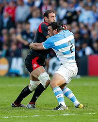 Georgia Number 8 Mamuka Gorgodze (capt) is tackled by Argentina Hooker Agustin Creevy (capt) - Mandatory byline: Rogan Thomson/JMP - 07966 386802 - 25/09/2015 - RUGBY UNION - Kingsholm Stadium - Gloucester, England - Argentina v Georgia - Rugby World Cup 2015 Pool C.