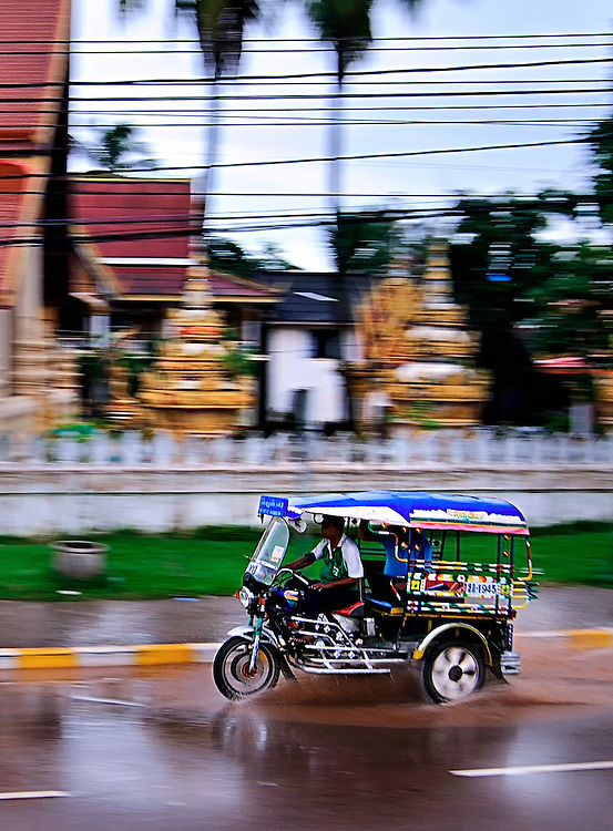 A tuk tuk on a rainy day in Vientiane.