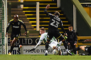 Sam Surridge (14) of Yeovil Town goes down in the penalty box from a challenge from Callum Kennedy (23) of AFC Wimbledon but nothing is awarded during the EFL Trophy match between Yeovil Town and AFC Wimbledon at Huish Park, Yeovil, England on 5 December 2017. Photo by Graham Hunt.