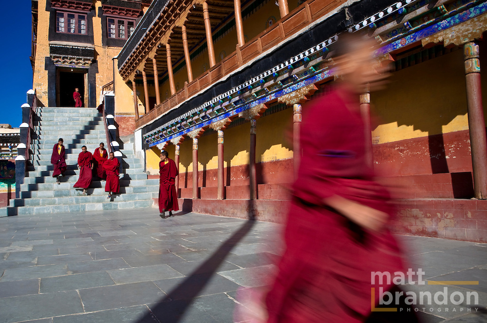 Buddhist monks leave Tiksey monastery after morning prayers.
