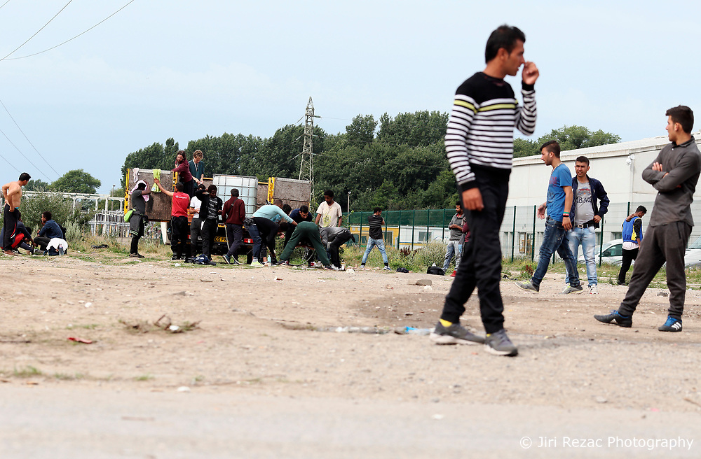FRANCE CALAIS 2AUG17 - Refugees from various nationalities gather around a truck distributing drinking water at an industrial estate in Calais, northern France.<br /> <br /> jre/Photo by Jiri Rezac<br /> <br /> &copy; Jiri Rezac 2017