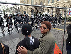 March 30, 2013 - Memphis, Tennessee, U.S. - Onlookers are kept behind a fence as Memphis police are out in force for scheduled KKK and anti-KKK rallies. The Ku Klux Klan announced plans to protest in Memphis after the Memphis City Council renamed three Confederate-themed city parks in February. (Credit Image: © Mark Weber/The Commercial Appeal/ZUMAPRESS.com)