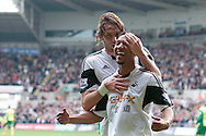 Jonathan De Guzman of Swansea city celebrates with Michu after scoring his sides 1st goal<br /> Barclays premier league match , Swansea city v Norwich city at the Liberty stadium in Swansea, South Wales on Saturday 29th March 2014.<br /> pic by Phil Rees, Andrew Orchard sports photography.