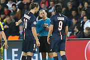 Referee Cüneyt Çakır (turkey) speaks with Paris Saint-Germain Zlatan Ibrahimović (vice captain) and Paris Saint-Germain Edinson Cavani during the Champions League match between Paris Saint-Germain and Chelsea at Parc des Princes, Paris, France on 17 February 2015. Photo by Phil Duncan.