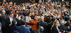 October 27, 2016 - Winston-Salem, NC, USA - Supporters vie to touch and take photos of Democratic candidate for President Hillary Clinton, center, and and first lady Michelle Obama, left, after they finish a campaign rally at Joel Coliseum in Winston-Salem, N.C., on Thursday, Oct. 27, 2016. (Credit Image: © Chuck Liddy/TNS via ZUMA Wire)