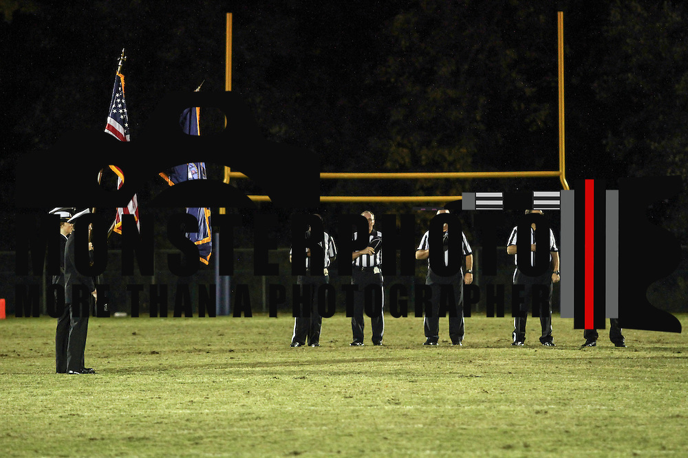 Game officials stand at attention during the the playing of the National Anthem prior a Week 8 DIAA football game between Laurel and Delaware Military Academy Saturday, Oct. 29, 2016, at Baynard Stadium in Wilmington.