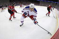 Mar 6; Newark, NJ, USA; New York Rangers left wing Ruslan Fedotenko (26) controls the puck while being defended by New Jersey Devils defenseman Adam Larsson (5) during the first period at the Prudential Center.