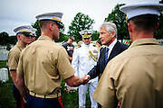 Secretary of Defense Chuck Hagel greets Marines during a Memorial Day visit to Arlington National Cemetery in Arlington Virginia, USA on 27 May, 2013.