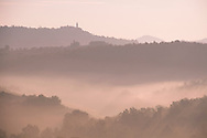 Early morning mist over the hills around Pienza, Val d'Orcia, Tuscany, Italy