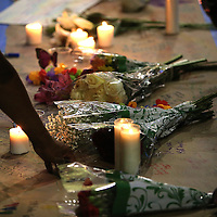 Flowers and candles are seen at a makeshift memorial during a vigil at the Dr. Phillips Center for the Performing Arts for the victims of a mass shooting at the Pulse nightclub Monday, June 13, 2016, in Orlando, Florida.  A gunman killed dozens of people in a massacre at the crowded gay nightclub in Orlando on Sunday, making it the deadliest mass shooting in modern U.S. history. (Alex Menendez via AP)