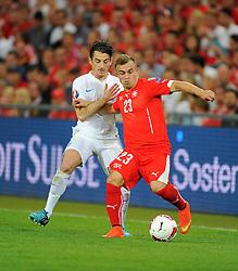 England's Leighton Baines (Everton) battles for the ball with Switzerland's Xherdan Shaqiri - Photo mandatory by-line: Joe Meredith/JMP - Mobile: 07966 386802 - 08/09/14 - SPORT - FOOTBALL - Switzerland - Basel - St Jacob Park - Switzerland v England - Uefa Euro 2016 Group E Qualifier