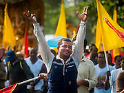 20 SEPTEMBER 2015 - SARIKA, NAKHON NAYOK, THAILAND: A man praises Ganesha while they walk to the river for the culmination of the Ganesh festival at Shri Utthayan Ganesha Temple in Sarika, Nakhon Nayok. Ganesh Chaturthi, also known as Vinayaka Chaturthi, is a Hindu festival dedicated to Lord Ganesh. Ganesh is the patron of arts and sciences, the deity of intellect and wisdom -- identified by his elephant head. The holiday is celebrated for 10 days. Wat Utthaya Ganesh in Nakhon Nayok province, is a Buddhist temple that venerates Ganesh, who is popular with Thai Buddhists. The temple draws both Buddhists and Hindus and celebrates the Ganesh holiday a week ahead of most other places.    PHOTO BY JACK KURTZ