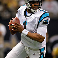 January 1, 2012; New Orleans, LA, USA; Carolina Panthers quarterback Cam Newton (1) looks to pass against the New Orleans Saints during the first half of a game at the Mercedes-Benz Superdome. Mandatory Credit: Derick E. Hingle-US PRESSWIRE