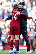 Liverpool Manager Jurgen Klopp and Liverpool midfielder Jordan Henderson (14) hug at the end of the Premier League match between Liverpool and Fulham at Anfield, Liverpool, England on 11 November 2018.