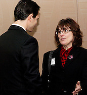 Denise Hamet of the City of Middletown (right) during the Dayton Area Chamber of Commerce Government Affairs Breakfast at the Crowne Plaza Hotel in downtown Dayton, Wednesday, November 30, 2011.