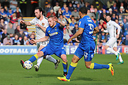 AFC Wimbledon midfielder Dean Parrett (18) battles for possession with Northampton Town midfielder John-Joe O Toole (21) during the EFL Sky Bet League 1 match between AFC Wimbledon and Northampton Town at the Cherry Red Records Stadium, Kingston, England on 11 March 2017. Photo by Matthew Redman.