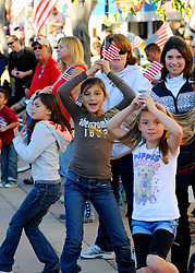From left, Isabel Mendoza, Vivianne Mendoza and Grace Callahan whoop it up during Sunday's well-attended 2nd Annual Monterey County Veteran's Day Parade in Oldtown Salinas.