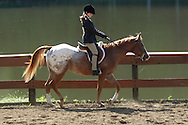 Middletown, NY - A young girl rides her horse at the Middletown Rotary Horse Show at Fancher Davidge Park on Sept. 16, 2007.