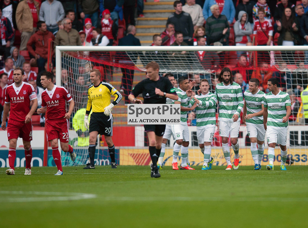 Kris Commons is congratulated by his teammates after scoring a penalty for Celtic. Aberdeen v Celtic , SPFL at Pittodrie, Saturday 17 August 2013 (c) ANGIE ISAC | SportPix.eu