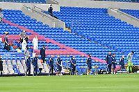Football - 2019 / 2020 Sky Bet EFL Championship - Cardiff City vs. Leeds United<br /> <br /> Cardiff bench stand for minutes silence before ko in front of empty stand in a match played with no fans after the cover 19 pandemic, at Cardiff City Stadium.<br /> <br /> COLORSPORT/WINSTON BYNORTH