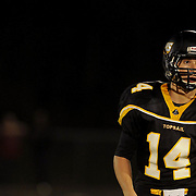 Topsail Quarterback Nick Altilio listens for plays.