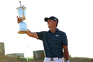 Jordan Spieth holds up the trophy after winning the 2015 U.S. Open at Chambers Bay in University Place, Wash. USA on Sunday, June 21, 2015<br /> Picture by: Mark Newcombe / visionsingolf.com
