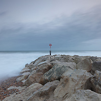 Stone jetty on rough seascape