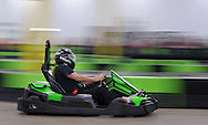 HORSHAM, PA - AUGUST 22: Fred Weizer, 76 of Mt. Ephraim, New Jersey speeds by on an electric go cart in heat 3 of the Granny Grampy Grand Prix at Speed Raceway August 22, 2014 in Horsham, Pennsylvania. Grandparents competed in electric go cart races to win a trip for four to Florida for the grandchild that entered them into the contest, which was sponsored by radio station WMMR. (Photo by William Thomas Cain/Cain Images)