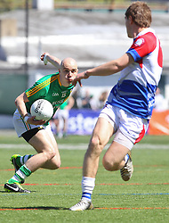 May 5, 2013; Bronx, NY; USA; Leitrim's Robbie Lowe (15) carries the ball during the first half at Gaelic Park.