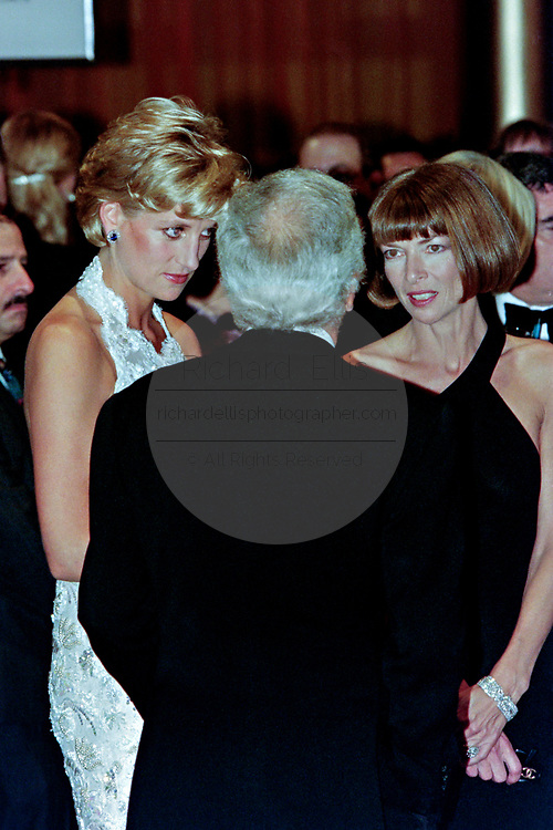 Diana, Princess of Wales chats with fashion designer Ralph Lauren, center, and Vogue Magazine editor Anna Wintour, right, during a charity gala fundraising event for the Nina Hyde Center for Breast Cancer Research September 24, 1996 in Washington, DC.