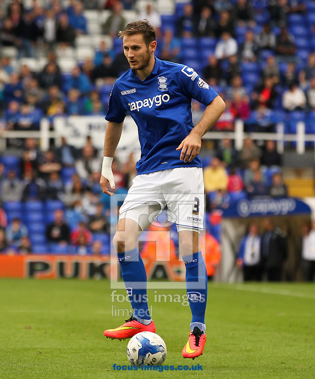 Jonathan Grounds of Birmingham City in possession of the ball during the Sky Bet Championship match at St Andrews, Birmingham<br /> Picture by Tom Smith/Focus Images Ltd 07545141164<br /> 27/09/2014