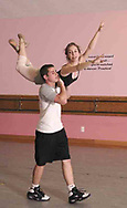 Austin Boucher lifts Grace Dutton at a rehearsal for the year-end recital at Terre's Dance Workshop in Kettering, Tuesday, May 8th.