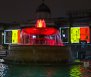 The fountains in Trafalgar Square flow red and yellow whilst Belgian flag is projected onto the National Gallery as London landmarks are illuminated in a display of solidarity with Belgium following the terror attacks on March 22nd. Westminster, London<br /> Picture by Paul Davey/Focus Images Ltd +447966 016296<br /> 23/03/2016