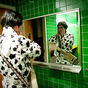 "January 14, 2012 ? ""Elvince,"" aka Vince Hill of Bellingham, attaches his sideburns in the men's restroom during the ?Seattle Invitationals? Elvis Tribute Artist competition at Seattle's EMP. To commemorate the 50th anniversary of the Seattle World's Fair, Elvis returned to the Seattle Center in the form of the impersonator competition."