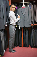 Full-length of tailor working at tailor shop