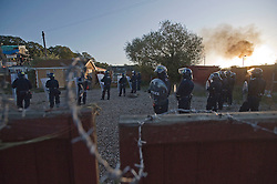 © Licensed to London News Pictures. 19/10/2011. Crays Hill, UK. Police wait to enter the site. Residents at Dale Farm, the UK's largest illegal traveller site being evicted today (19/10/2011) following a long dispute with Basildon Council . Travellers and activist had barricaded themselves in to the site in an attempt to prevent their eviction. Photo credit: Ben Cawthra/LNP
