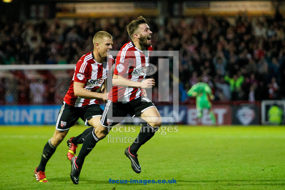 Stuart Dallas of Brentford celebrates scoring the winner during the Sky Bet Championship match between Brentford and Derby County at Griffin Park, London<br /> Picture by Mark D Fuller/Focus Images Ltd +44 7774 216216<br /> 01/11/2014