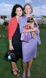 Left to right, actress MIMMI DRIVER and her sister KATE DRIVER with her dog Harry, at a polo match in Berkshire on 27th July 1997.MAR 124