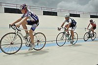 Max Thilen, 13, Carlos Rocha, 17, and Daniel Jimenez, 17, are riding their bicycles at the Bryan Piccolo park's velodrome on Monday June 29, 2009. Staff photo/Cristobal Herrera.