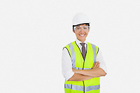 Portrait of Asian construction worker with arms crossed over white background