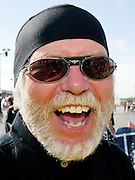 Willie G. Davidson, grandson of one of the original founders of Harley-Davidson William A. Davidson smiles after leading a parade of 10,000 Harleys in Milwaukee August 30, 2003. The legendary American motorcycle company is celebrating its 100th anniversary and is expected to draw 200,000 to 300,000 people to the companies home base over four days.    REUTERS/Rick Wilking