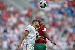 June 15, 2018 - Saint Petersburg, Russia - Omid Ebrahimi (L) of the Iran national football team and Karim El Ahmadi of the Morocco national football team vie for the ball during the 2018 FIFA World Cup match, first stage - Group B between Morocco and Iran at Saint Petersburg Stadium on June 15, 2018 in St. Petersburg, Russia. (Credit Image: © Igor Russak/NurPhoto via ZUMA Press)