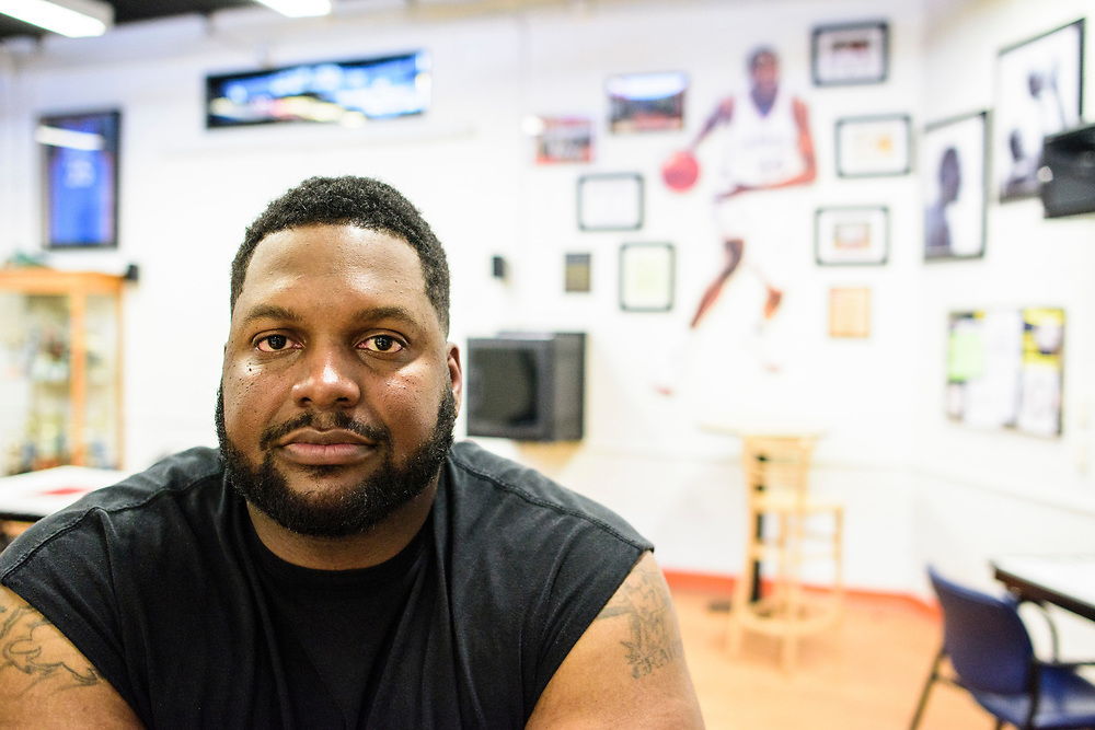 Capitol Heights, Maryland - March 29, 2017: Emmanuel &quot;Juicy&quot; Jackson, 34, sits in the Seat Pleasant Activity Center's Kevin Durant Den March 29, 2017. The former member of the Army and current Capital Hill Police officer has been going to the Activity Center since he was &quot;six or seven.&quot; He still used the facility to keep in shape. He grew up with Kevin Durant and Charles &quot;Chuckie&quot; Craig was his basketball coach, too.<br /> <br /> NBA super star Kevin Durant has donated a substantial amount of money to help renovate the Seat Pleasant Activity Center where he learned to play basketball. Durant's AAU coach and mentor Charles &quot;Chuckie&quot; Craig, who worked at the Activity Center, was gunned down in May 2005 at the age of 35. Durant wears #35 in Craig's honor.<br /> <br /> <br /> NBA Superstar Kevin Durant's jersey number &quot;35&quot; is a tribute to his rec. league coach and mentor Charles &quot;Chuckie&quot; Craig, who was gunned down in at a night club in Laurel, Md., in 2005 when he was 35 years old. <br /> <br /> CREDIT: Matt Roth for The New York Times<br /> Assignment ID: 30204524A