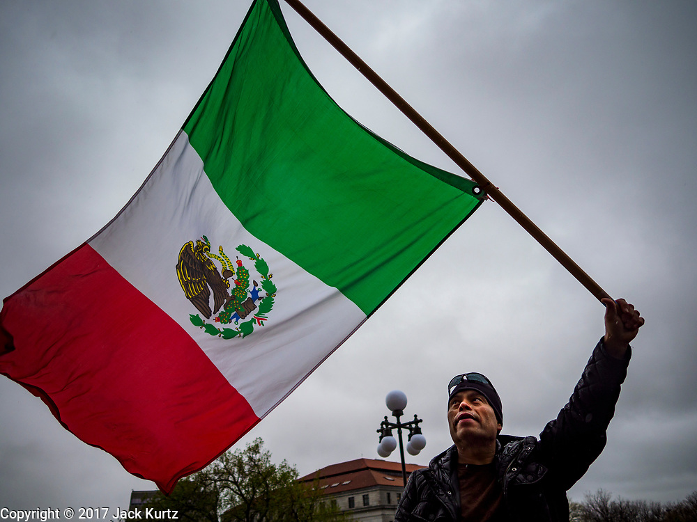 01 MAY 2017 - ST. PAUL, MN: A man waves a Mexican flag during a May Day immigrants' rights march at the Minnesota State Capitol. About 300 people, representing immigrants' and workers' rights organizations, marched through the Minnesota State Capitol during a demonstration to mark May Day, International Workers' Day.      PHOTO BY JACK KURTZ