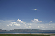"""SHOT 6/9/16 3:39:17 PM - Bear Lake is a natural freshwater lake on the Utah-Idaho border in the Western United States. About 109 square miles in size, it is split about equally between the two states. The lake has been called the """"Caribbean of the Rockies"""" for its unique turquoise-blue color, which is due to the reflection of calcium carbonate (limestone) deposits suspended in the lake. The lake is a popular destination for tourists and sports enthusiasts, and the surrounding valley has gained a reputation for having high-quality raspberries. (Photo by Marc Piscotty / © 2016)"""