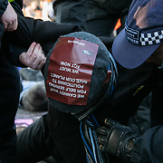 Thousands of Extinction Rebellion activists took over 5 bridges in Central London and blocked them for the day, November 17 2018, Central London, United Kingdom. Lambeth Bridge; a young activist is arrested and taken away. Around 11am people on all bridges sat down in the road and blocked traffic from coming through and stayed till late afternoon. The actvists believe that the government is not doing enough to avoid catastrophic climate change and they demand the government take radical action to save future generations and the planet. Many are willing to be arrested peacefully protesting and up to 80 were arrested on the day.. Extinction Rebellion is a grass root climate change group started in 2018 and has gained a huge following of people commited to peaceful protests and who ready to be arrested. Their major concern is that the world is facing catastropohic climate change and they want the British government to act now to save future generations.