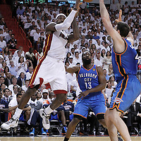 21 June 2012: Miami Heat small forward LeBron James (6) passes the ball during the Miami Heat 121-106 victory over the Oklahoma City Thunder, in Game 5 of the 2012 NBA Finals, at the AmericanAirlinesArena, Miami, Florida, USA. The Miami Heat wins the series 4-1.