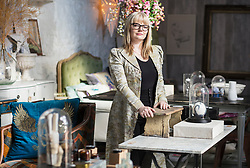 Female Business Owner in her Furnishing Shop